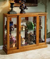 Specialty Lighting Curio Cabinet Curios Styling And Decorating Curio Cabinets How To Guides