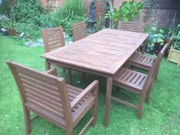 large garden table and 8 chairs good condition medium oak
