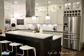 what to do with space above kitchen cabinets use of space over the cabinets i like that they re open but still