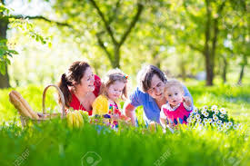 Family Gard Young Family With Kids Having Picnic Outdoors Parents With Two