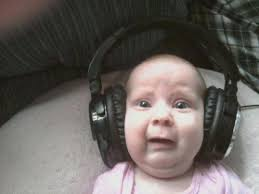 omg what could this baby possibly be listening to baby