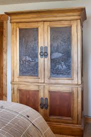 dick idol armoire in master bedroom features pressed tin mountain dick idol armoire in master bedroom features pressed tin mountain vignette the piece doubles as