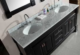 brown wooden vanity with cream counter top and sink above combined