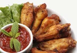 cuisiner des ailes de poulet ailes de poulet à l orange et à la coriandre coup de pouce