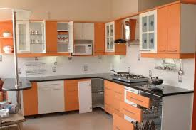 large kitchen with orange display windows design by interior