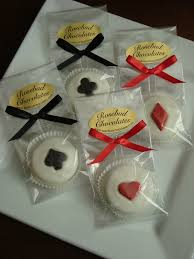 white chocolate dipped oreo cookies with playing card symbols