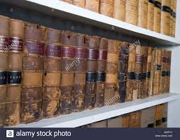 legal books and law reports on a bookshelf in lawyers chambers in
