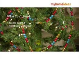 decorating a tree with beaded garland