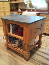 lovely repurposed kitchen island with blue marble countertops and