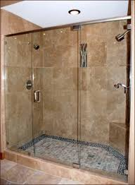 Clear Glass Shower Door by Bathroom Marble Tile Wall Pebble Tile Floor Round Chrome Shower