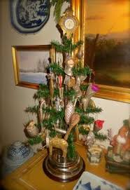 antique feather tree decorated with antique glass dresden and