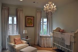 girls room chandelier nursery traditional with armchair bassinet