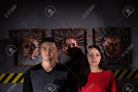 scary halloween images free young man and woman in front of skinned faces for scary halloween