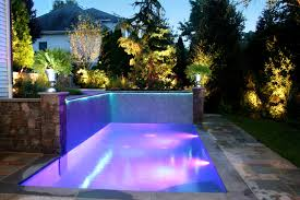 small inground pool designs with purple outdoor lights around pool