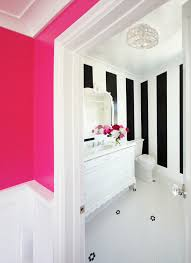 high contrast pink hallway and black u0026 white striped bathroom