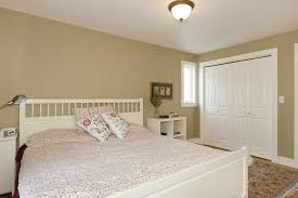cottage master bedroom with carpet hardwood floors in seattle