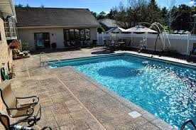 creating the look of stones on a residential pool deck concrete