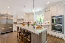 white kitchen cabinets with island white kitchen with drift wood accent island in randolph