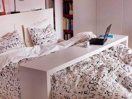 Ikea Bedroom Ideas by Ikea Malm Occasional Table Glides Over Mattress For Working Or