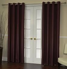 minimalist living room with grommet french door curtain panel and