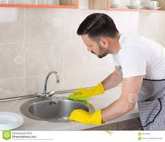 man cleaning kitchen sink stock photo image 95137940