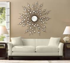 large constellation style sunburst mirror over contemporary white