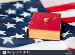 Flag With Bible Close Up Of American Flag Wedding Rings And Bible Stock Photo