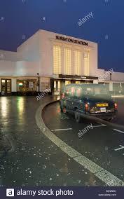 surbiton station art deco facade at night kingston upon stock