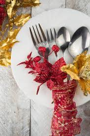 red and silver christmas table settings christmas table setting in gold and red tone on wooden table stock