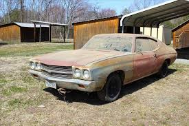auto junkyard network parts yard in mercury salvage muscle cars cougar carcass at desert