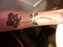 collection of 25 quotes words tattoos on forearm