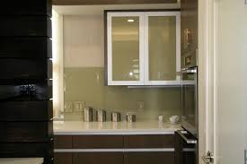 pretty clear glass door white frame kitchen cabinet over grey wall pretty clear glass door white frame kitchen cabinet over grey wall tile backsplash and gloss porcelain countertop minimalist with