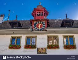 old town of thun house with bell tower and clock bernese