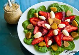 strawberry spinach salad with green almonds and poppy seed