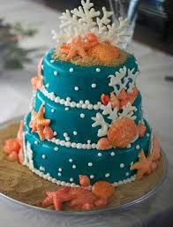 tier round turquoise beach theme wedding cake with sea shells and