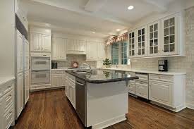 colored kitchen cabinets with black countertops pairing countertops with light cabinets for a