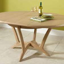 extendable round dining table beautiful expandable round dining table plans photos liltigertoo