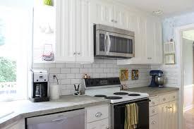 home design backsplash ideas cream cabinets corian countertops