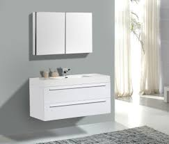white wooden bathroom vanity with marble top and round white sink