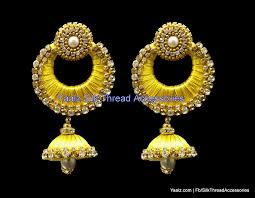 earing image yaalz chand bali jhumka earring with gold zari work in mustard yellow