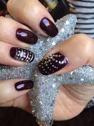 cnd shellac in dark lava with nail art and swarovski crystal