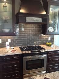 glass tile backsplash with dark cabinets ice gray glass subway tile dark brown cabinets subway tile