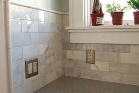 clear subway tile white kitchen cabinets black countertops and