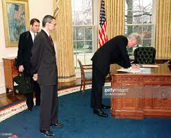 us president bill clinton work at his desk in the pictures getty