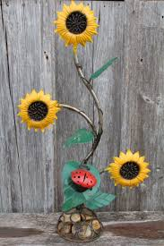 metal sunflowers on a rock base garden flowers yard accent