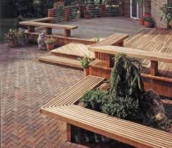 deck with curved built in seat and planters an outdoor deck with
