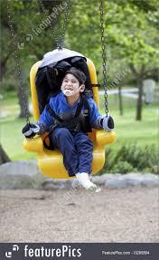handicap swing happy disabled boy on handicap swing image