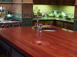 jatoba wood countertop photo gallery by devos custom woodworking jatoba edge grain custom wood island countertop with hand carved trash cover