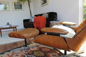 plycraft eames style lounge chair and kilim rug modern