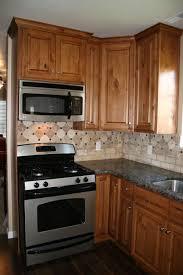 striking country kitchen ideas with oak cabinets above dark brown